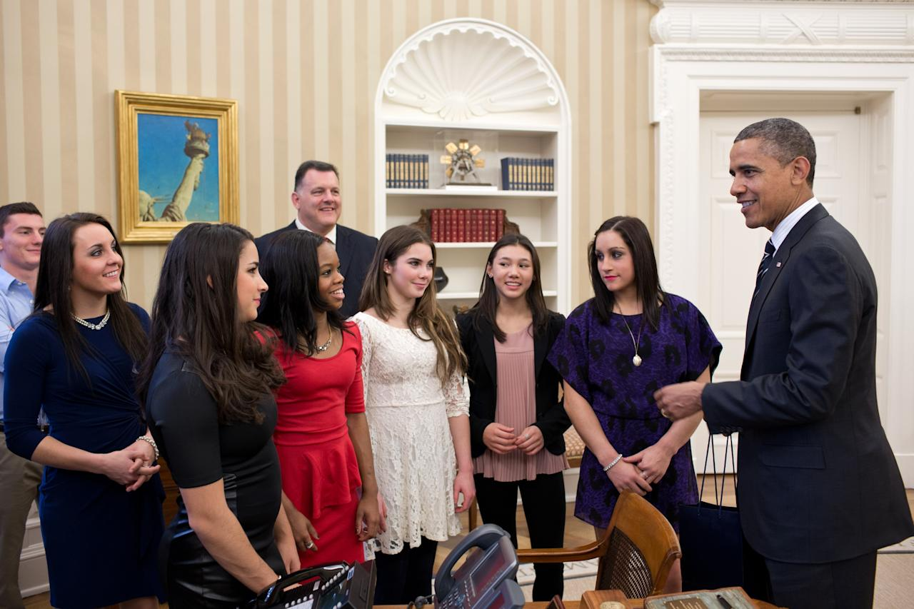 WASHINGTON, DC - NOVEMBER 15:  In this handout image provided by The White House, U.S. President Barack Obama (R) talks with members of the 2012 U.S. Olympic gymnastics teams (L-R) Steven Gluckstein, Savannah Vinsant, Aly Raisman, Gabby Douglas, Steve Penny, USA Gymnastics President, McKayla Maroney, Kyla Ross, and Jordyn Wieber in the Oval Office November 15, 2012 at the White House in Washington, DC.  (Photo by Pete Souza/The White House via Getty Images)