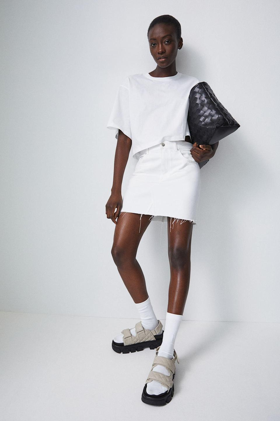 <p>Go for an all-white assemble with the <span>H&amp;M Denim Skirt</span> ($25).</p>