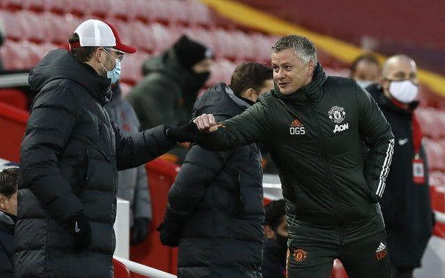 Liverpool manager Jurgen Klopp, left, and Manchester United boss Ole Gunnar Solskjaer were left with a point apiece following a dismal draw at Anfield