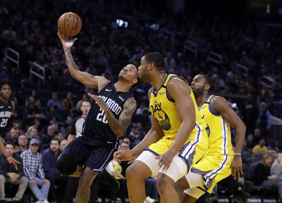 Orlando Magic's Markelle Fultz, left, shoots past Golden State Warriors' Omari Spellman, right, during the first half of an NBA basketball game Saturday, Jan. 18, 2020, in San Francisco. (AP Photo/Ben Margot)