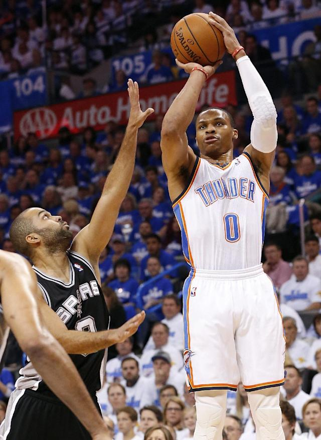 Oklahoma City Thunder guard Russell Westbrook (0) shoots over San Antonio Spurs guard Tony Parker (9) in the first quarter of Game 4 of the Western Conference finals NBA basketball playoff series in Oklahoma City, Tuesday, May 27, 2014. (AP Photo/Sue Ogrocki)