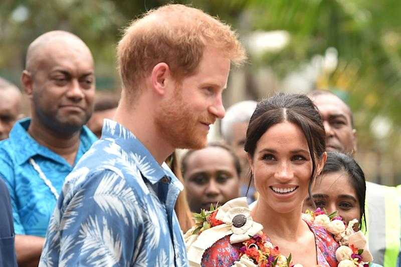Britain's Meghan, Duchess of Sussex looks at Prince Harry as they visit the University of the South Pacific in Suva on October 24, 2018. - British royal Meghan Markle recounted her own struggles to afford her university degree as she passionately promoted female education to Fijian students in her first speech of the Oceania royal tour on October 24. (Photo by PETER PARKS / AFP) (Photo credit should read PETER PARKS/AFP/Getty Images)