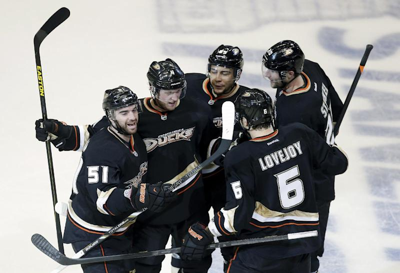 Anaheim Ducks right wing Kyle Palmieri, from left, celebrates his goal with Cam Fowler, Emerson Etem, Ben Lovejoy (6) and David Steckel during the first period in Game 5 of their first-round NHL hockey Stanley Cup playoff series against the Detroit Red Wings in Anaheim, Calif., Wednesday, May 8, 2013. (AP Photo/Chris Carlson)