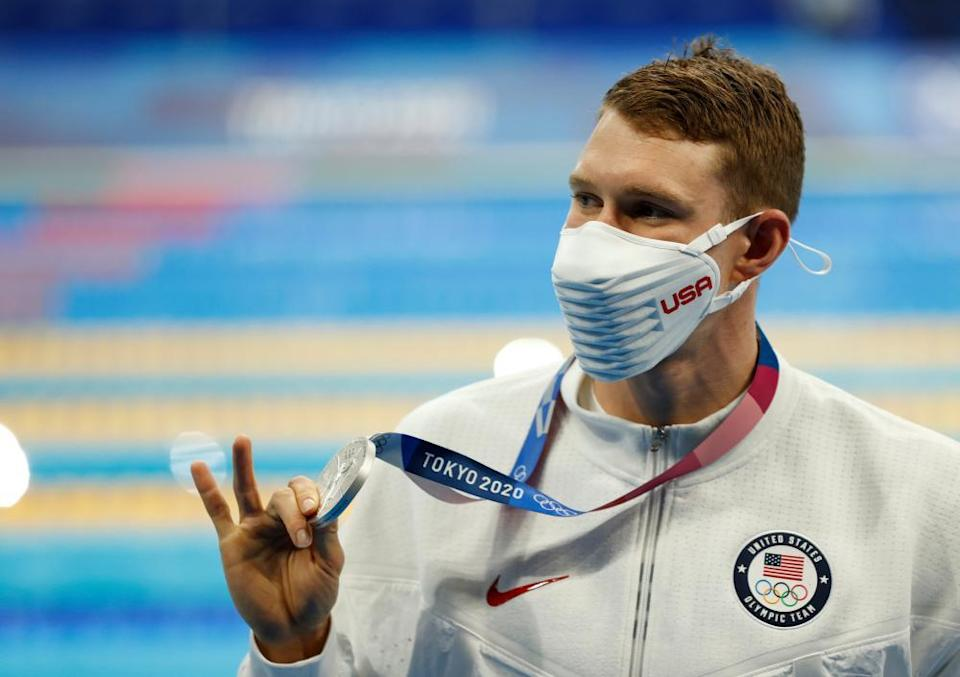 Ryan Murphy of the USA shows his silver medal from the men's 200m backstroke final.
