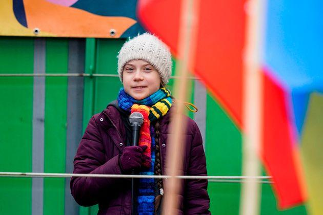 Greta Thunberg speaks at a climate march in Brussels, Belgium in early March. She says she started experiencing mild coronavirus symptoms not long after she returned home.