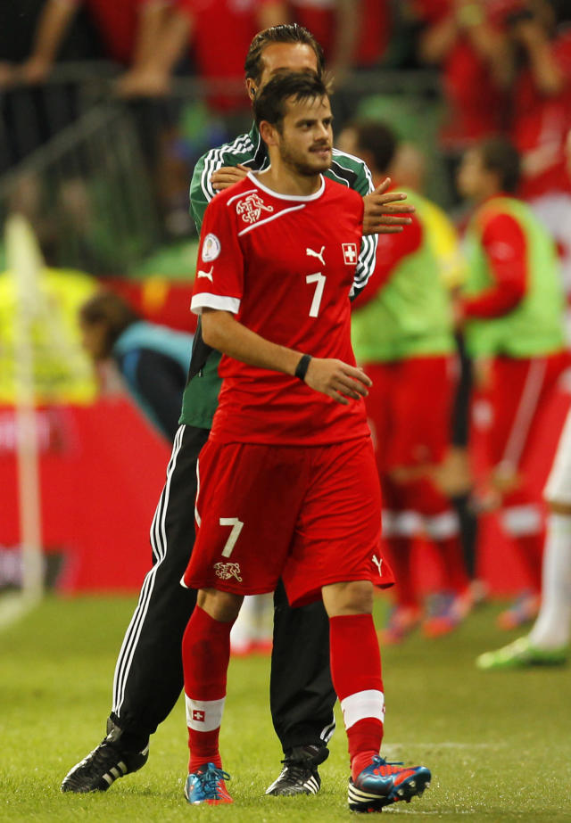 FILE - In this Sept. 7, 2012, file photo, Switzerland's Tranquillo Barnetta reacts after receiving a red card during the 2014 FIFA World Cup group E qualifier soccer match between Slovenia and Switzerland in Ljubljana, Slovenia. There is undoubted quality throughout the side, starting with keeper Diego Benaglio, a German championship winner in 2009 with VfL Wolfsburg. The combination of experienced players such as Tranquillo Barnetta, Gokhan Inler and Philippe Senderos, with highly-talented youngsters Xherdan Shaqiri, Fabian Schar, Granit Xhaka and Valentin Stocker, has borne fruit and the side are more than capable of making their mark at Brazil 2014. (AP Photo/Filip Horvat, File)