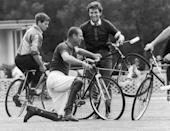 <p>After colliding with a teammate, Prince Philip falls off his bicycle during an attempt at bicycle polo. </p>