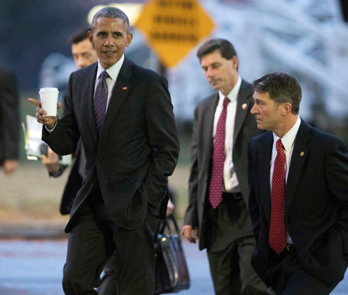 FILE - In this Nov. 29, 2016, file photo, President Barack Obama walks with his physician Dr. Ronny Jackson, right, towards a waiting Marine One as he leaves Walter Reed National Military Medical Center in Bethesda, Md., after visiting wounded service members. Now it's Washington's turn to examine Jackson. The doctor to Presidents George W. Bush, Barack Obama and now Donald Trump is an Iraq War veteran nominated to head the Department of Veterans Affairs. (AP Photo/Manuel Balce Ceneta, File)