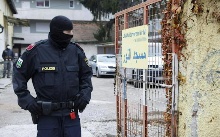 "This photo taken on November 9, 2020 in Graz, Austria, shows the Liga Kulturverein, where a police raid, dubbed Operation Luxor, took place in the early morning. - Austrian police launched raids on more than 60 addresses allegedly linked to radical Islamists in four different regions on November 9, with orders given for 30 suspects to be questioned, prosecutors said. The Styria region prosecutors' office said in a statement it was ""carrying out investigations against more than 70 suspects and against several associations which are suspected of belonging to and supporting the terrorist Muslim Brotherhood and Hamas organisations"". (Photo by ERWIN SCHERIAU / APA / AFP) / Austria OUT (Photo by ERWIN SCHERIAU/APA/AFP via Getty Images) - ERWIN SCHERIAU/AFP"