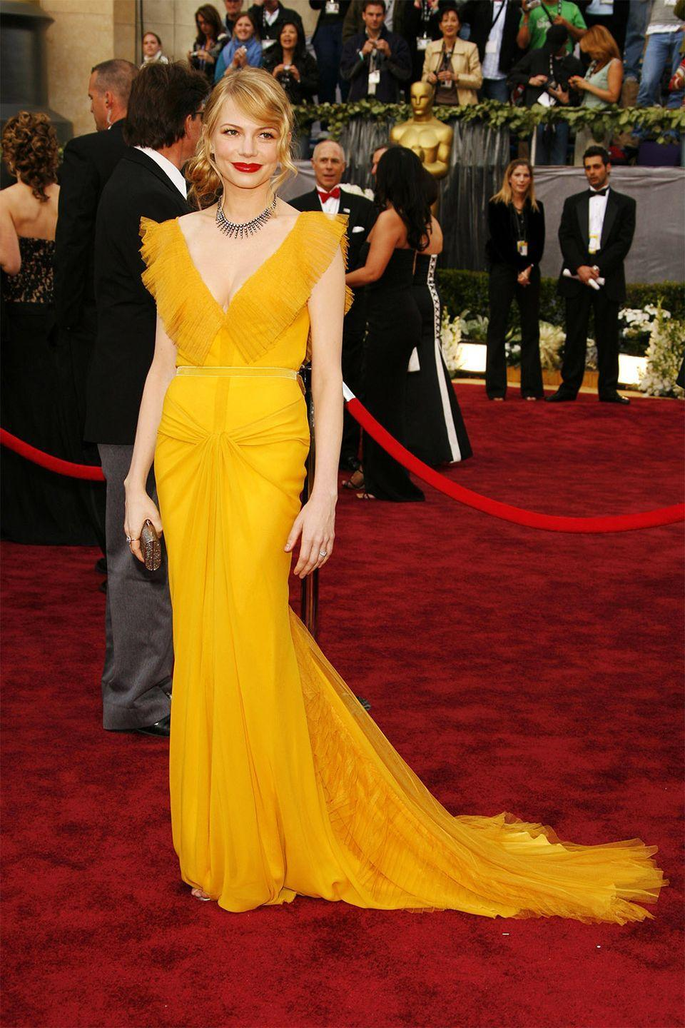 <p>Michelle Williams's saffron Vera Wang dress has become one of the most memorable fashion moments. The actress attended with her then-boyfriend, the late Heath Ledger, who was nominated for his role in <em>Brokeback Mountain, </em>where they both met. </p>