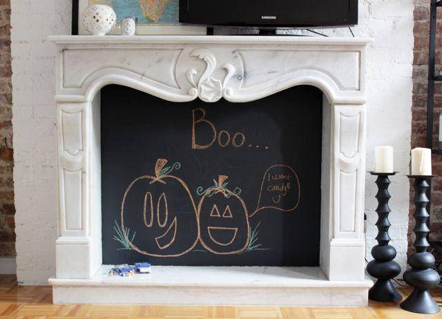 "<p>Alicia Lund of <a href=""https://cheetahisthenewblack.com/uncategorized/diy-chalkboard-fireplace/"" target=""_blank"">Cheetah Is the New Black</a> swathed her decorative marble fireplace in two coats of Benjamin Moore's <a href=""https://www.housebeautiful.com/home-remodeling/diy-projects/a27287825/chalkboard-paint/"" target=""_blank"">chalkboard paint.</a> Then, she simply drew a fun Halloween scene to work as a nice backdrop. </p><p><a class=""body-btn-link"" href=""https://www.amazon.com/Renaissance-Chalk-Finish-Paint-Eco-Friendly/dp/B06VX1PLSQ/ref=asc_df_B06VX1PLSQ/?tag=syn-yahoo-20&ascsubtag=%5Bartid%7C10057.g.2554%5Bsrc%7Cyahoo-us"" target=""_blank"">BUY NOW</a> <strong><em>Chalk Finish Paint, $20</em></strong></p>"