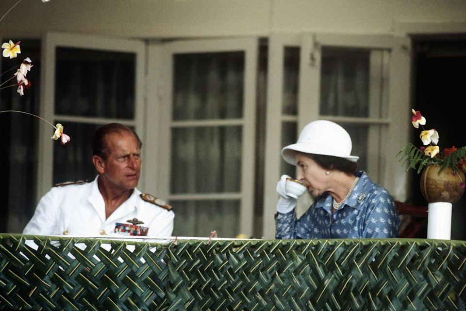 <p>The Queen sips her tea in Nauru during her and Prince Philip's tour of the South Pacific islands.<br></p>