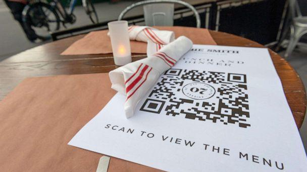 PHOTO: A paper menu with a QR code to encourage touchless ordering is on display at The Smith's outdoor seating near Lincoln Center as New York City moves into Phase 3 of re-opening, on July 13, 2020. (Alexi Rosenfeld/Getty Images, File )