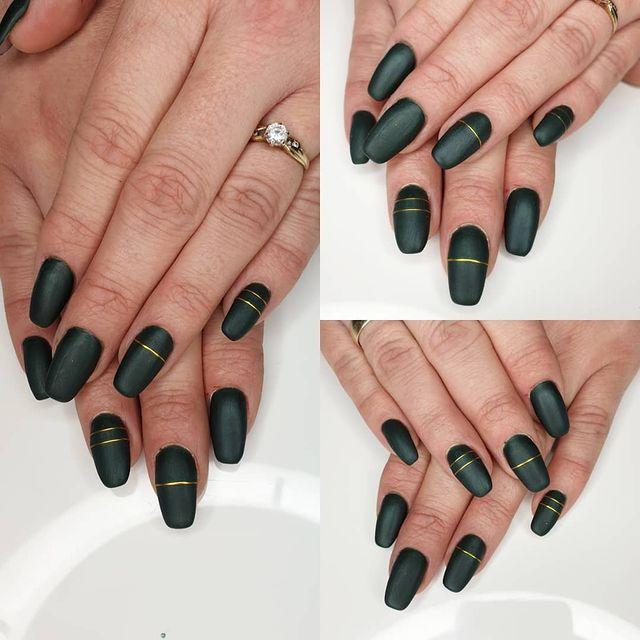 """<p>If you want a some nails that are festive but won't make you feel silly on March 17th, take a look at this manicure. The understated hunter green fits right in with the holiday, without looking over the top. Try gold nail tape for a straight, clean accent line.</p><p><a class=""""link rapid-noclick-resp"""" href=""""https://www.amazon.com/Striping-FANDAMEI-Multicolor-Decoration-Sticker/dp/B07V82JFVN/?tag=syn-yahoo-20&ascsubtag=%5Bartid%7C10055.g.26310821%5Bsrc%7Cyahoo-us"""" rel=""""nofollow noopener"""" target=""""_blank"""" data-ylk=""""slk:SHOP GOLD NAIL TAPE"""">SHOP GOLD NAIL TAPE</a> </p><p><a href=""""https://www.instagram.com/p/B7HUN5gDOqq/&hidecaption=true"""" rel=""""nofollow noopener"""" target=""""_blank"""" data-ylk=""""slk:See the original post on Instagram"""" class=""""link rapid-noclick-resp"""">See the original post on Instagram</a></p>"""