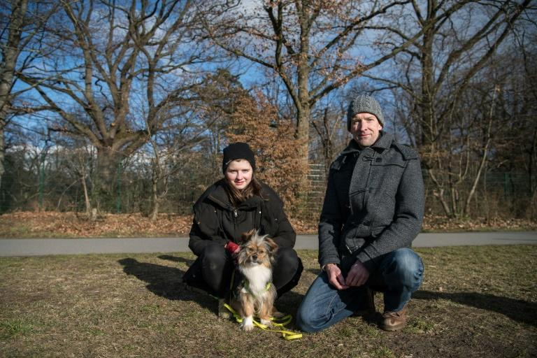 Adopted dog Uschi, with her new owners Annelie and Markus Salomon in Berlin's Hasenheide park