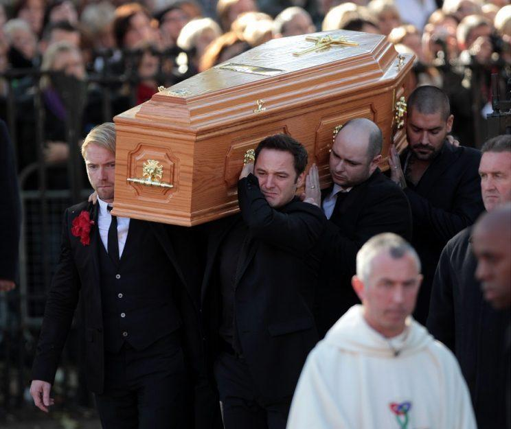 Stephen's Boyzone bandmates were pall bearers at his funeral Copyright: Rex