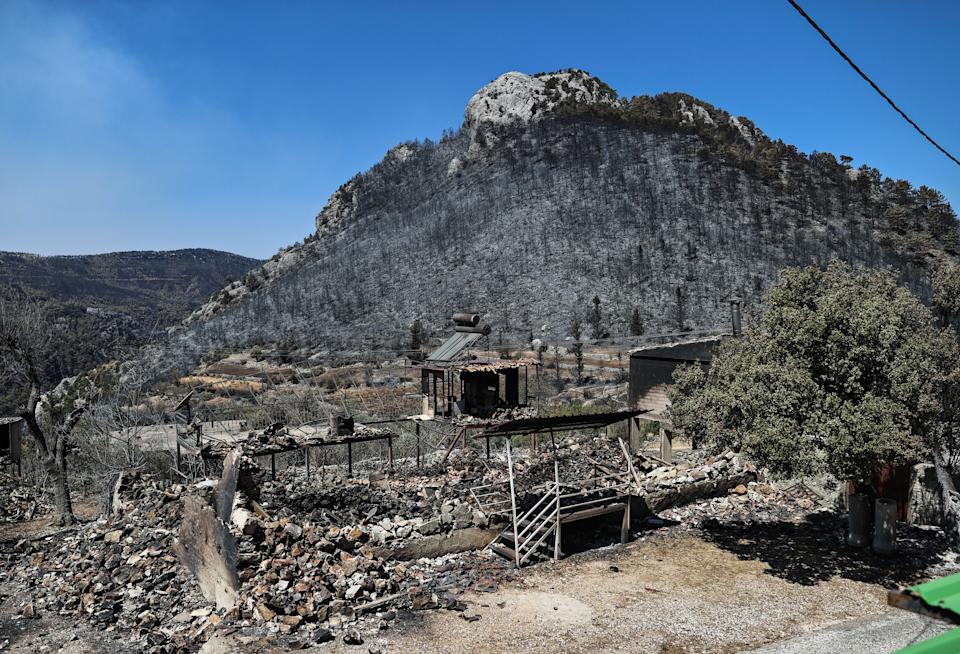 ANTALYA, TURKEY - AUGUST 02: A view of the damaged building and the area after forest fires in Kepezbeleni neighborhood in Akseki district of Antalya, Turkey on August 02, 2021. (Photo by Islam Yakut/Anadolu Agency via Getty Images)