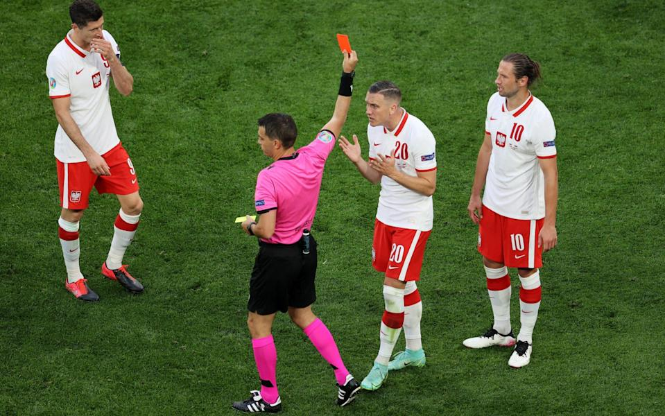 Grzegorz Krychowiak receives a classic no-look red card - GETTY IMAGES