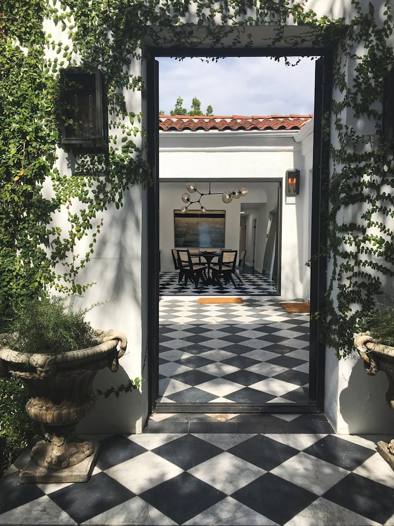 """""""These [checkered floors] came with the house!"""" says Alice. """"Talk about a score: They read a bit loud before we started working on the project, but the contrast tied in well at the end, and grounded our airy, minimal palette."""""""