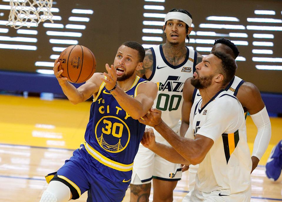 Steph Curry (30) scored 36 points in the Warriors' 119-116 win over the Utah Jazz, clinching a spot for Golden State in the play-in tournament.