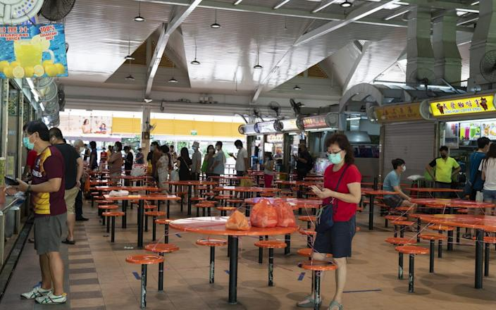 Queues for takeaways have returned to Singapore after its ban on indoor dining - Wei Leng Tay/Bloomberg