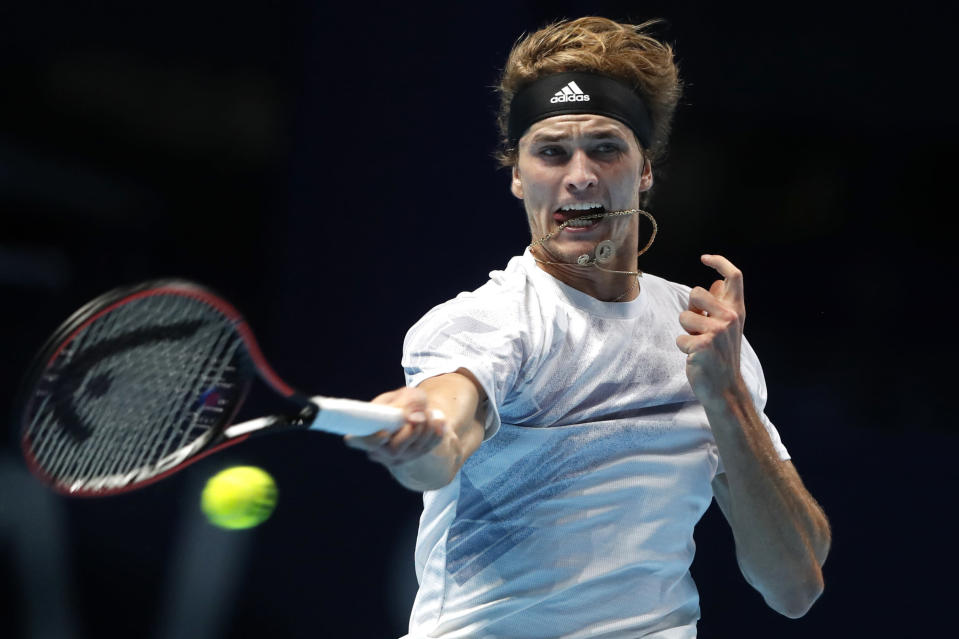 Alexander Zverev of Germany plays a return to Daniil Medvedev of Russia during their singles tennis match at the ATP World Finals tennis tournament at the O2 arena in London, Monday, Nov. 16, 2020. (AP Photo/Frank Augstein)