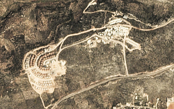 This satellite image provided by Planet Labs Inc. shows the West Bank Jewish settlement of Bruchin on March 6, 2017. Satellite photos and data obtained by the AP document for the first time the full impact of the pro-settlement policies of then-President Donald Trump. (Planet Labs Inc. via AP)