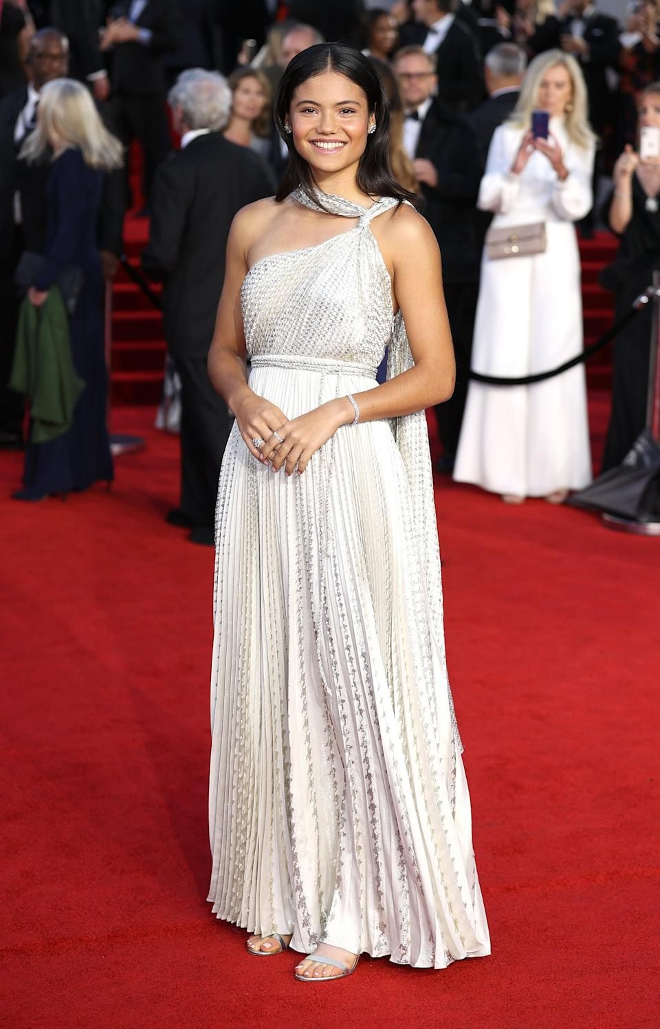 <p>Raducanu wore a white, one-shoulder, Grecian-inspired dress from Dior's Resort 2022 collection. Her jewelry - including tennis bracelet, earrings, and rings - was from Tiffany &amp; Co. </p>