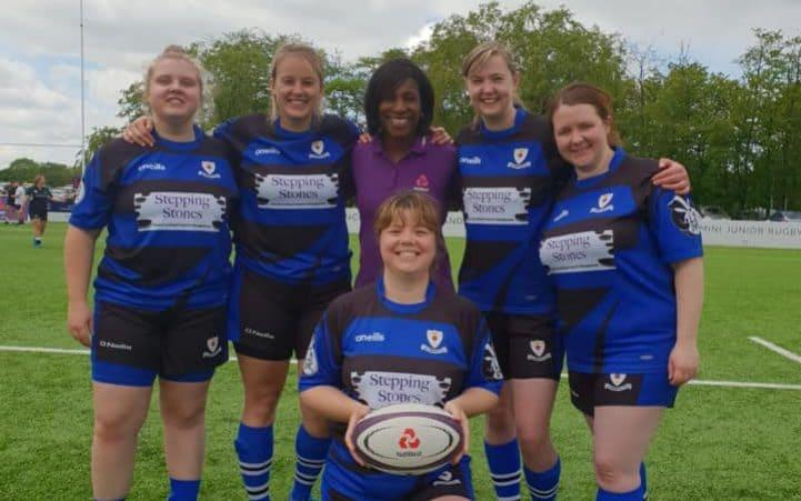 Members of Glossop Amazones RUFC with former England flanker Maggie Alphonsi. Alex Gradwell-Spencer kneels with the ball. From left to right: Gabi McGregor, Katie Haley, Alex Gradwell-Spencer, Emily Scouler and Laura Edwards