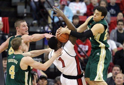 UNLV's Quintrell Thomas, center, tries to pull down a rebound between Colorado State's Colton Iverson, left rear, Pierce Hornung (4) and Dorian Green (22) during the first half of an NCAA college basketball game Wednesday, Feb. 20, 2013, in Las Vegas. (AP Photo/Isaac Brekken)