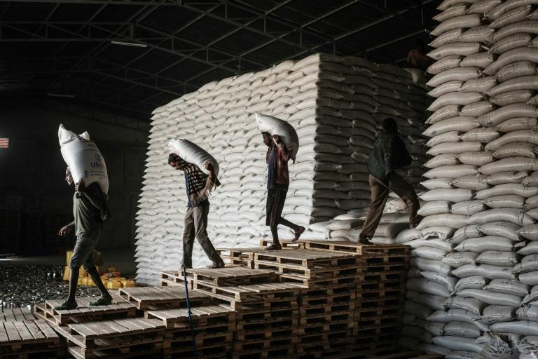 Workers in Mekele carrying sacks of wheat for food distribution organised by a local NGO, the Relief Society of Tigray