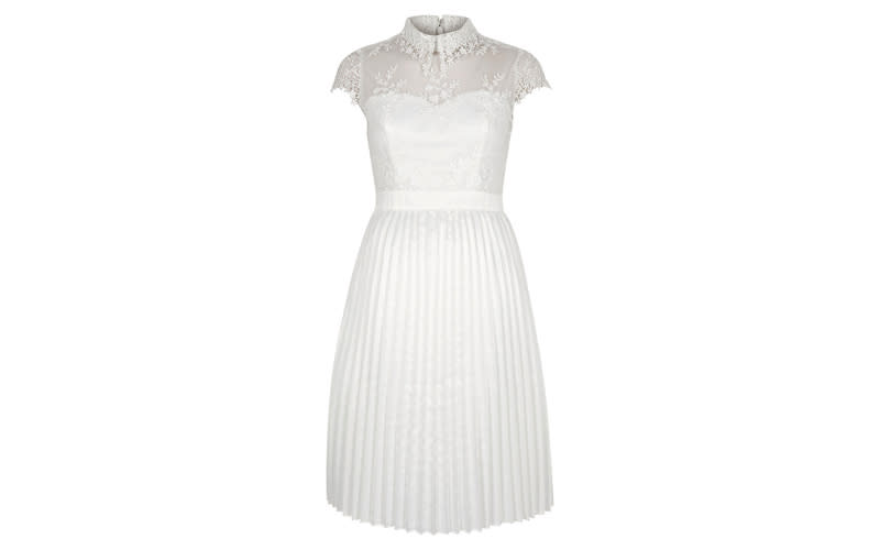 """<p>If you'd rather splurge on a wedding venue and the all-important honeymoon, then look no further than Chi Chi London for a wide array of bridal dresses. If you're after something that will take you from day-to-night then opt for a shorter number – perfect for dancing in. <em><a rel=""""nofollow noopener"""" href=""""https://www.riverisland.com/p/chi-chi-london-white-lace-pleated-prom-dress-732766"""" target=""""_blank"""" data-ylk=""""slk:Shop now"""" class=""""link rapid-noclick-resp"""">Shop now</a>.</em> </p>"""