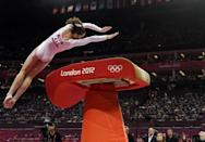 <p>U.S. gymnast McKayla Maroney performs during the artistic gymnastics women's vault finals at the 2012 Summer Olympics, Sunday, Aug. 5, 2012, in London. (AP Photo/Julie Jacobson) </p>