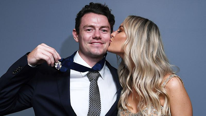 Lachie Neale is seen here alongside his wife Julie.