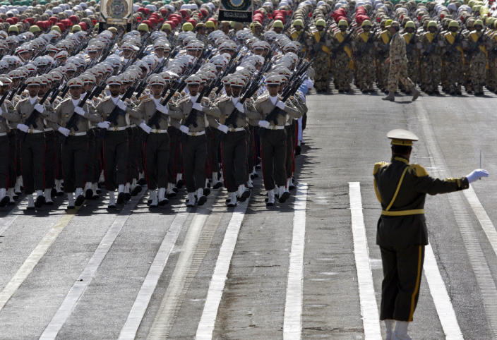Iranian army troops march, as a band leader conducts a military band, not shown, during a military parade commemorating the start of the Iraq-Iran war 32 years ago, in front of the mausoleum of the late revolutionary leader Ayatollah Khomeini, just outside Tehran, Iran, Friday, Sept. 21, 2012. (AP Photo/Vahid Salemi)