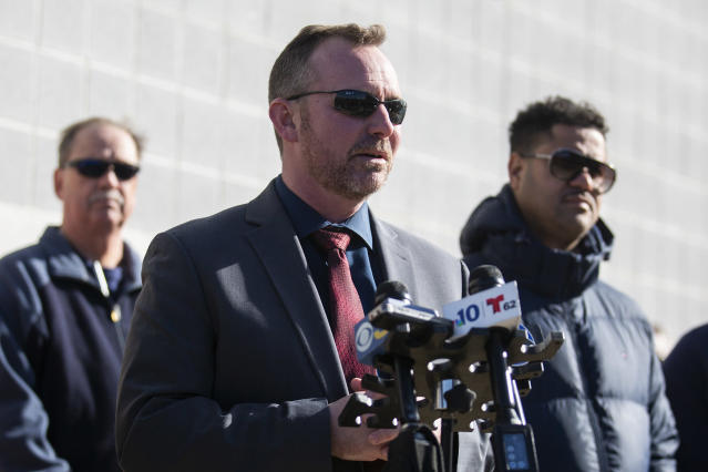 Sean Riggin, chief of Police in Pleasantville, N.J., speaks with media on Saturday at Pleasantville High School regarding the shooting at a football game between Camden High School and Pleasantville. (Tyger Williams/The Philadelphia Inquirer via AP)
