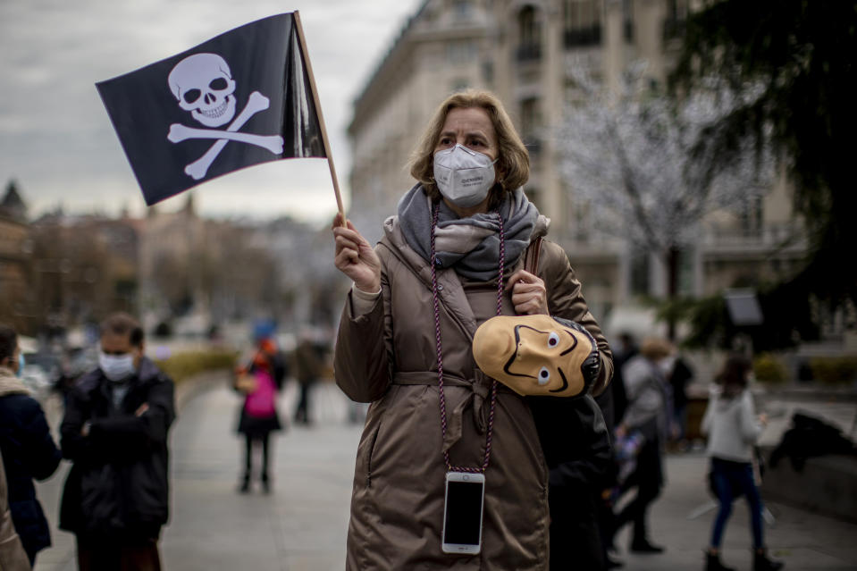 """People protest against a law to legalize euthanasia in front of the Spanish Parliament in Madrid, Spain, Thursday, Dec. 17, 2020. The Spanish Parliament debates on votes on a bill to legalize euthanasia for those people suffering """"unbearably"""" from a chronic or incurable disease. (AP Photo/Manu Fernandez)"""