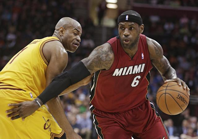 Miami Heat's LeBron James, right, drives around Cleveland Cavaliers' Jarrett Jack during the second quarter of an NBA basketball game Tuesday, March 18, 2014, in Cleveland. (AP Photo/Tony Dejak)