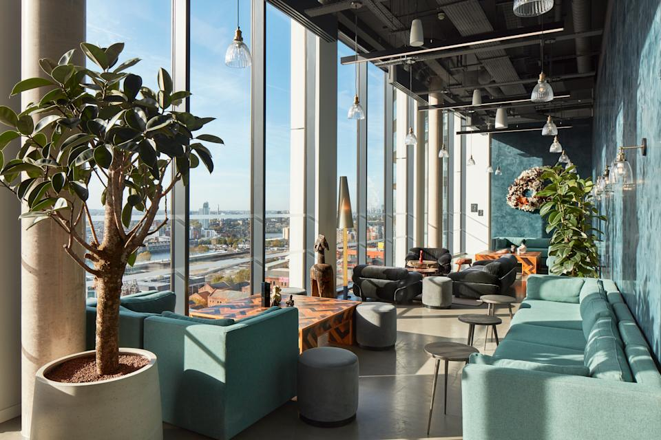 The lounge of Mthr, The Collective Canary Wharf's bar and restaurant, is featured in this photo.