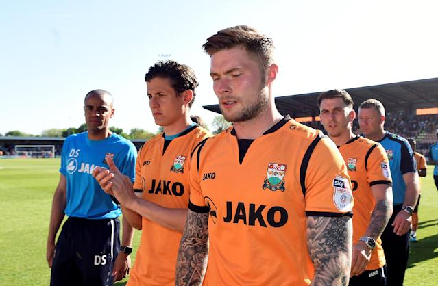 "Soccer Football - League Two - Barnet vs Chesterfield - The Hive, London, Britain - May 5, 2018 Barnet players look dejected after the match as they are relegated from the Football League Action Images/Adam Holt EDITORIAL USE ONLY. No use with unauthorized audio, video, data, fixture lists, club/league logos or ""live"" services. Online in-match use limited to 75 images, no video emulation. No use in betting, games or single club/league/player publications. Please contact your account representative for further details."
