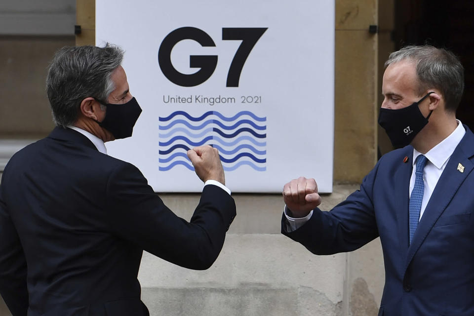 US Secretary of State Antony Blinken, left, is greeted by Britain's Foreign Secretary Dominic Raab at the start of the G7 foreign ministers meeting in London Tuesday May 4, 2021. G7 foreign ministers meet in London Tuesday for their first face-to-face talks in more than two years. (Ben Stansall / Pool via AP)