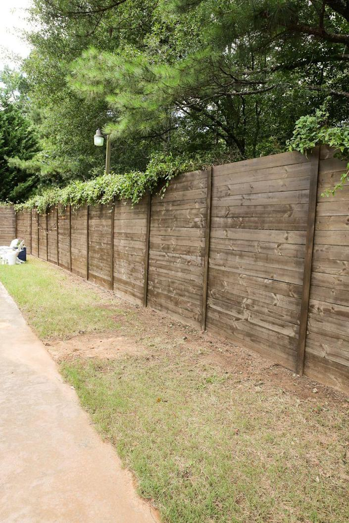 "<p>This beautiful fence has a secret: It's hiding an ugly, old chain link fence! The pre-fab panels are attached with metal brackets and cable ties. Genius!</p><p><strong>Get the tutorial at <a href=""https://www.bowerpowerblog.com/how-to-build-a-wood-fence-on-a-chainlink-fence/"" rel=""nofollow noopener"" target=""_blank"" data-ylk=""slk:Bower Power"" class=""link rapid-noclick-resp"">Bower Power</a>.</strong></p><p><a class=""link rapid-noclick-resp"" href=""https://go.redirectingat.com?id=74968X1596630&url=https%3A%2F%2Fwww.homedepot.com%2Fp%2FCommercial-Electric-8-in-Cable-Tie-Natural-1000-Pack-GT-200ST%2F203531925&sref=https%3A%2F%2Fwww.thepioneerwoman.com%2Fhome-lifestyle%2Fgardening%2Fg32651791%2Fdecorative-garden-fence-ideas%2F"" rel=""nofollow noopener"" target=""_blank"" data-ylk=""slk:SHOP CABLE TIES"">SHOP CABLE TIES</a></p>"