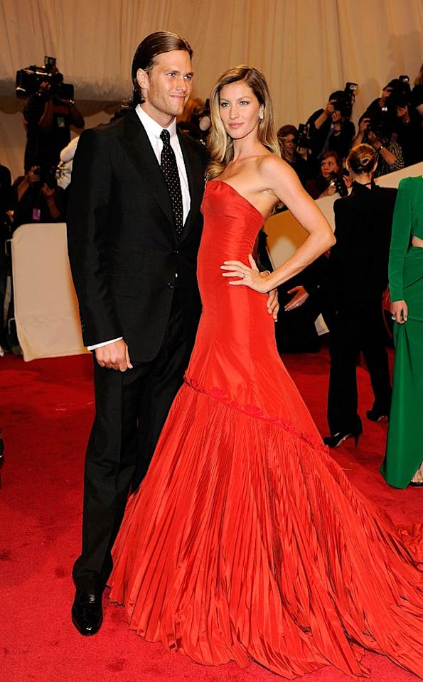"Quarterback Tom Brady rocked a slicked-back 'do and black suit, while wife, model Gisele Bundchen, popped a pose in a cherry-red McQueen gown and freshly highlighted locks. Kevin Mazur/<a href=""http://www.wireimage.com"" target=""new"">WireImage.com</a> - May 2, 2011"