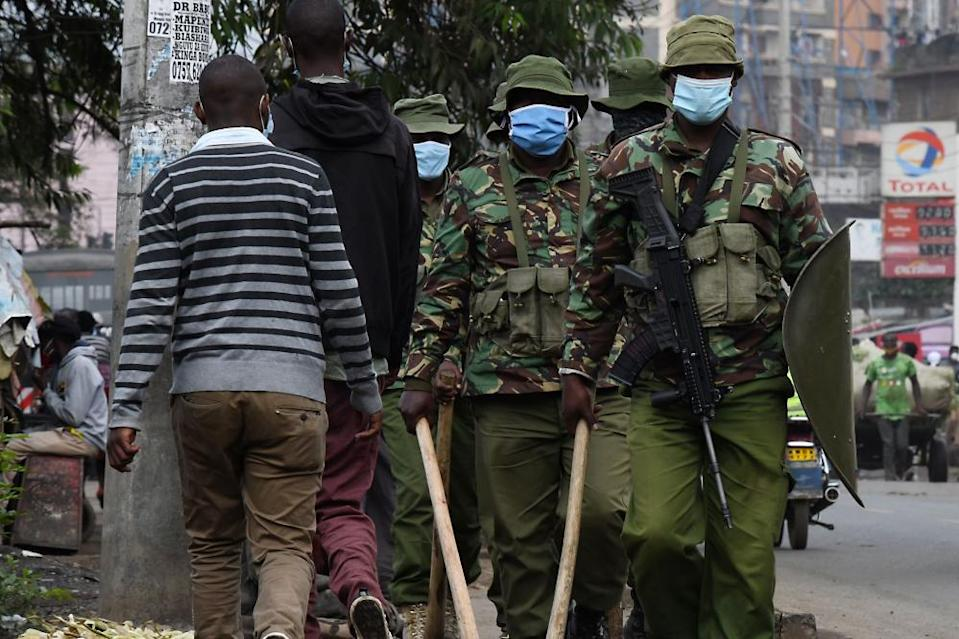 Heavily armed police officers patrol in Eastleigh, Nairobi, in May.