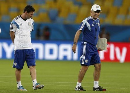 Argentine national soccer team player Lionel Messi stands next to coach Alejandro Sabella during a training session for the 2014 World Cup at the Maracana stadium in Rio de Janeiro, June 14, 2014. REUTERS/Pilar Olivares