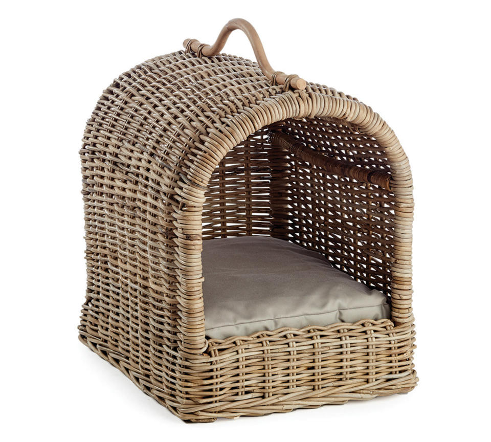 This photo provided by Pottery Barn shows the company's Canopy Pet Bed. No longer are furniture companies content to offer you staples like a sofa, easy chair and bed. Now they have those items for your pet, too, designed not to clash with the rest of your decor. Pottery Barn, Crate and Barrel, Ikea, Casper mattresses and other popular furniture purveyors have lines for pets, often in styles that complement their human-size living room furniture. (Pottery Barn via AP)