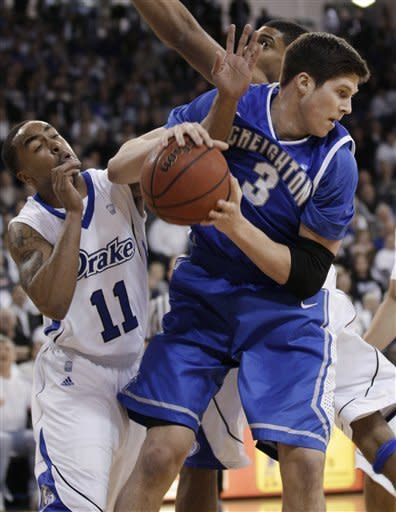 Creighton forward Doug McDermott fights for a rebound with Drake guard Karl Madison (11) during the first half of an NCAA college basketball game Wednesday, Jan. 25, 2012, in Des Moines, Iowa. (AP Photo/Charlie Neibergall)