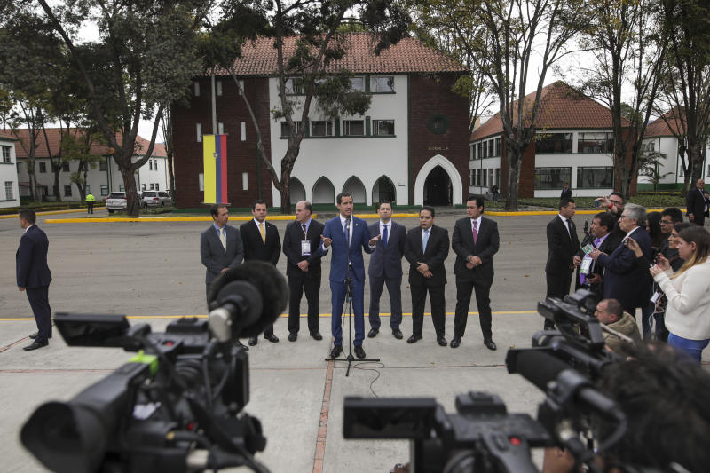 Venezuela's opposition leader Juan Guaido holds a press conference after attending a regional counter-terrorism meeting at the police academy in Bogota, Colombia, Monday, Jan. 20, 2020. Colombian President Ivan Duque and U.S. Secretary of State Mike Pompeo also attended. (AP Photo/Ivan Valencia)