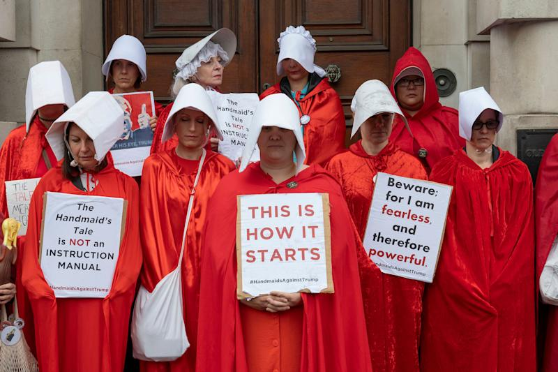 Women dressed as Handmaidens during a demonstration against U.S. President Donald Trump. (Photo: Sam Mellish / In Pictures via Getty Images)