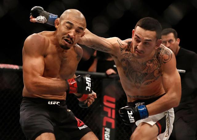 Max Holloway, right, defeated Jose Aldo by TKO at UFC 212. (Getty)